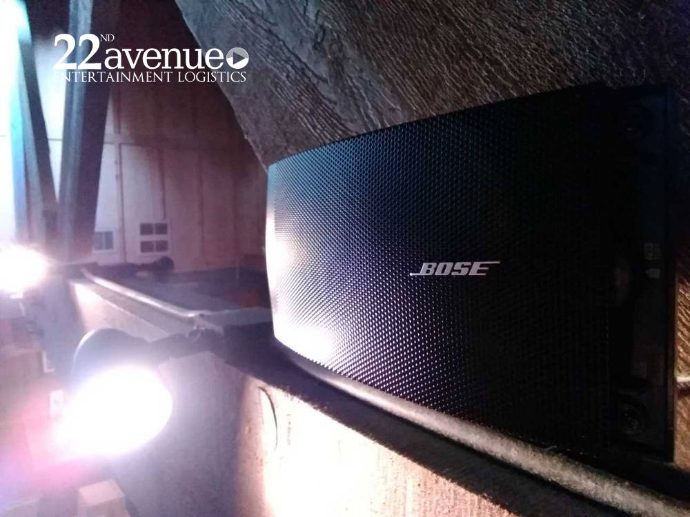 bose speaker installed in rafters commercial sound